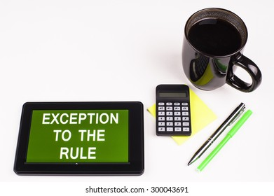 Business Term / Business Phrase on Tablet PC - Cup of coffee, Pens, Calculator and a green/yellow note pad on a White surface - White Word(s) on a green background - Exception To The Rule