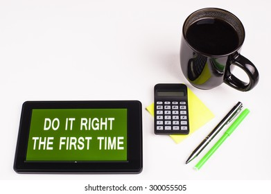 Business Term / Business Phrase on Tablet PC - Cup of coffee, Pens, Calculator and a green/yellow note pad on a White surface - White Word(s) on a green background - Do It Right The First Time