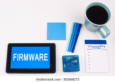Business Term / Business Phrase on Tablet PC - Blues, cup of coffee, Pens, paper clips Calculator with a blue note pad on a White Background - White Word(s) on a blue background - Firmware