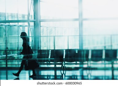 Business town. The silhouette of the person walking in the lobby.