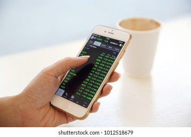 business trading online on smartphone with woman hand