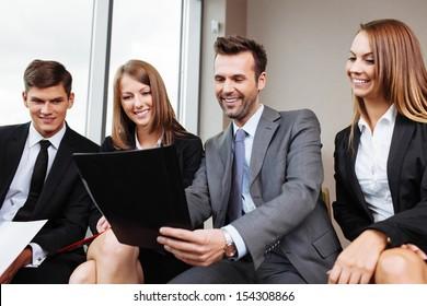 Business training. Coach teaching employees