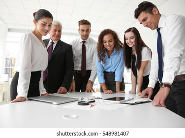 Business training concept. Colleagues looking at tablet screen in office