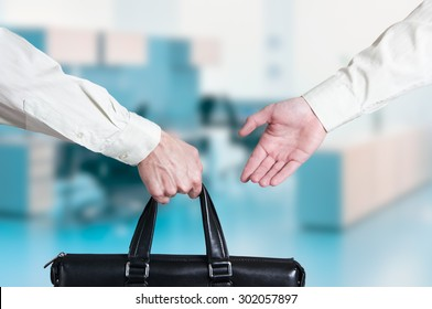business transfer deal. handover of a suitcase for money partners.