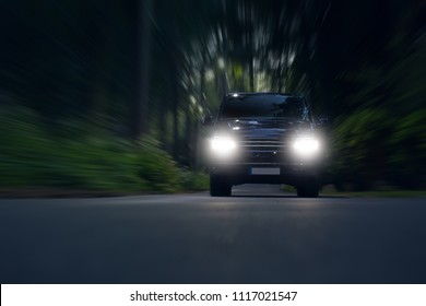 Business transfer vip van ride fast in forest. Luxury minivan car in motion. Xenon light in night