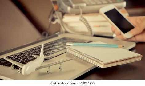 Business Travel Agency working on office desk