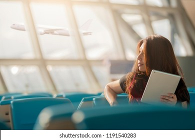 Business traveler waiting with airport background.
