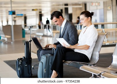 business travellers waiting for their flight at airport