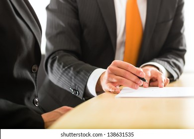 Business - Two businesspeople or professionals have a conversation in an office