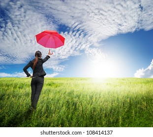 Business umbrella woman standing to blue sky in grassland with red umbrella
