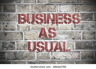 Business as usual painted sign on a brick wall