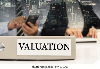 business valuation document on desk with investment adviser and businessman meeting.