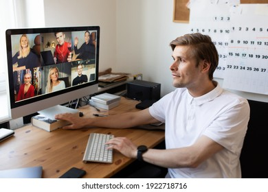 Business video conferencing. Young man having video call via computer in the home office. Multiethnic business team. Virtual house party. Online team meeting video conference calling from home