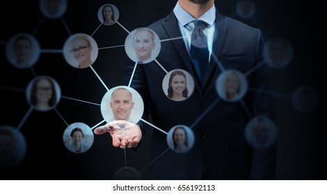 business, virtual reality, future technology, cyberspace and people - businessman with network contacts over black background