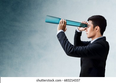 Business Vision and Leadership Concept, Businessman Looking or Searching for Success via transparent Telescope monocular, Side view
