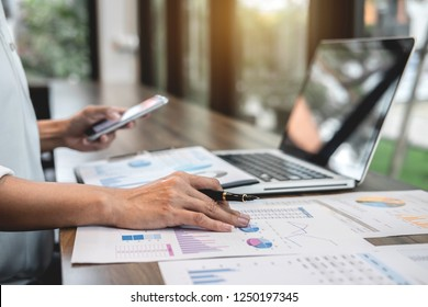 Business woman accountant working audit and calculating expense financial annual financial report balance sheet statement, doing finance making notes on paper checking document.