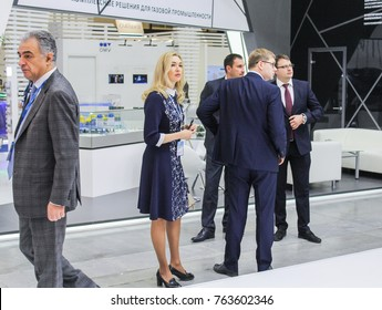Business woman among men. St. Petersburg, Russia - 3 October, 2017. Participants and visitors of the annual St. Petersburg Gas Forum.