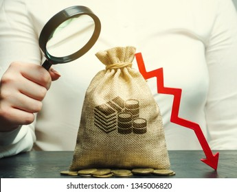 Business woman analyzes the budget in the company. Reduced profits. Financial crisis and bankruptcy. Bad business. Loss of investment and capital flight. Financial instability. Unprofitability