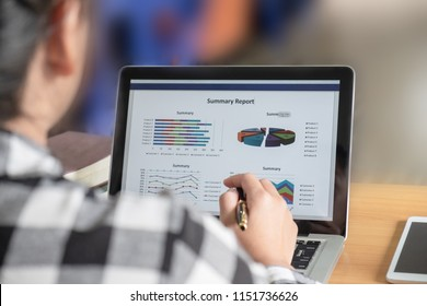 Business woman analyzing investment charts in laptop screen at morning time.
