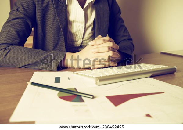 Business woman analyzing investment charts with vintage style