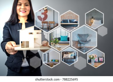 Business woman (architect - interior designer) in formalwear working on futuristic virtual screen with realistic home image while holding house model / Modern real estate & future renovation concept