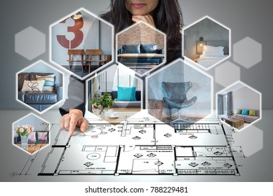 Business woman (architect - interior designer) in formalwear working on futuristic virtual screen with realistic home image / Modern real estate & future renovation concept