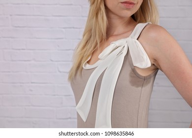 Business woman armpit sweating. Transpiration stain. Hyperthyroidism concept