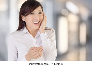 Business woman of Asian with surprised expression.
