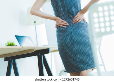 Business woman with back pain in office.Asian