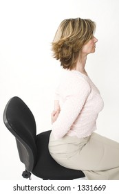 business woman back pain on chair