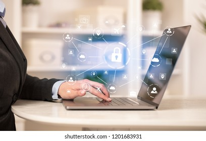 Business woman below chest working on laptop in a cozy homey environment with secured connection concept