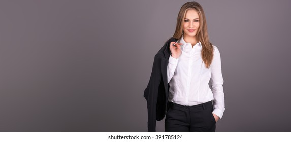 Business woman with big left copy space holding a jacket