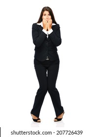 Business woman biting her nails is nervous and scared.    Isolated on a white background.