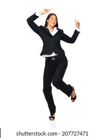 Business woman in a black suit dancing is happy cheerful.    Isolated on a white background.