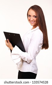 Business woman with blank page on clip board facing camera.