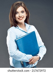 Business woman blue shirt dressed. Smiling office worker.