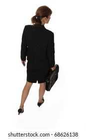 Business woman with briefcase walking away