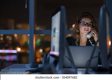 Business woman calling on the phone late at night to business partner from another time zone