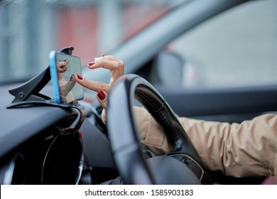 business woman in the car touching the mobile put on the handsfree