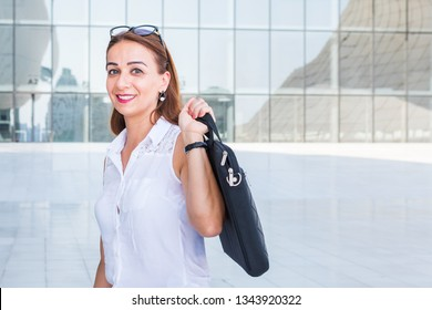 business woman carries laptop