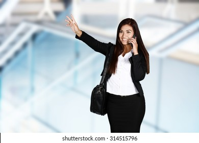 Business woman catching a ride in taxi