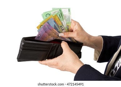 Business woman checking or taking Australian dollar from purse. Notes include $100, $50, $20 and $10.