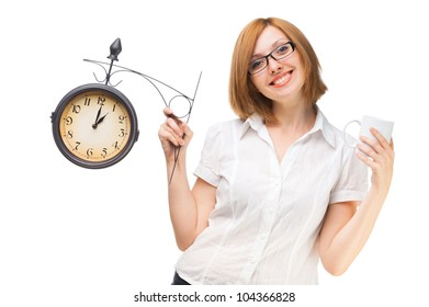 business woman with a clock and a cup in the lunch break at the office