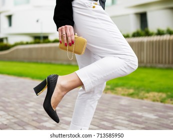 Business woman with clutch  wearing high heels