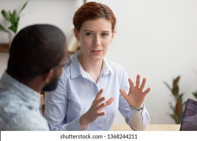 Business woman coach mentor manager consulting client intern, female caucasian insurance broker bank advisor make offer to african customer at meeting sell services talking explaining deal benefits
