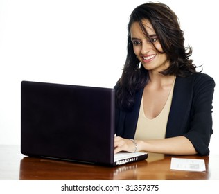 Business woman communicating through email and web conferencing