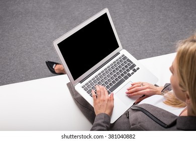 Business woman with computer in her lap