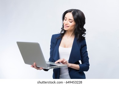 Business woman computer on a white-gray background