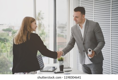 business woman with confidence handshake with partner