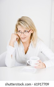 business woman with a cup in a bright office